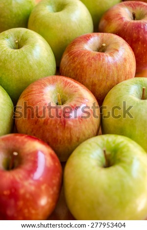 Frame filled with apples , from the lower left corner to the upper right corner is lined diagonal of red apples on the background of green apples. Diagonal of red apples. Vertical shot. - stock photo