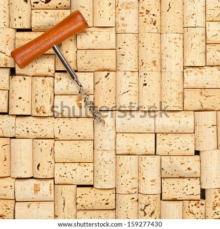 Frame filling blank wine corks with corkscrew background texture - stock photo