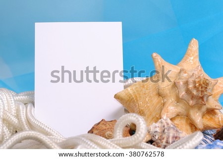 Frame for photo on a sea blue background with shell and rope. Just insert yours image in blank template - stock photo