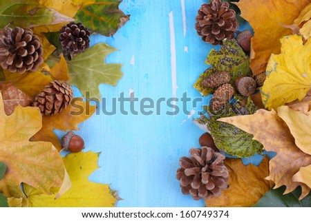 Frame from autumn leaves on wooden table close-up