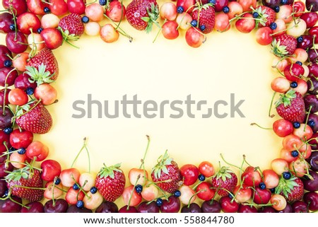 Frame from fruit for a card on a yellow background