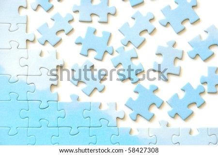 Frame from puzzle pieces. White background