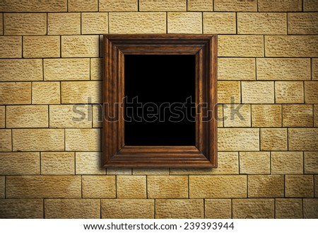 frame hanging on brick wall