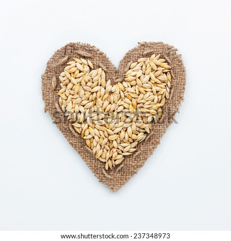 Frame in the shape of heart with  barley, on a white background