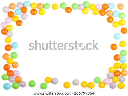 Frame made of colorful candy on a white background - stock photo