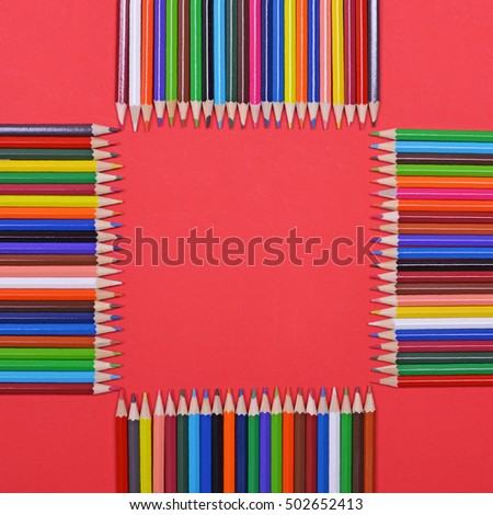 Frame made of colorful wooden pencils flat lay