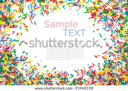 Frame made of little colorful sprinkles candy isolated on white background with sample text - stock photo