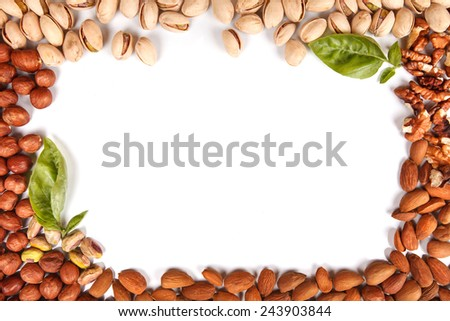 frame made of nuts pistachios walnuts almonds hazelnut isolated on white with space for writing - stock photo