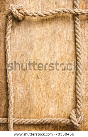 frame made of rope on the old board - stock photo