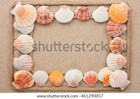 Frame made of rope with seashells on the sand, with space for your text