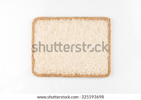 Frame made of the rope with rice  grain on a white background, with place for your text