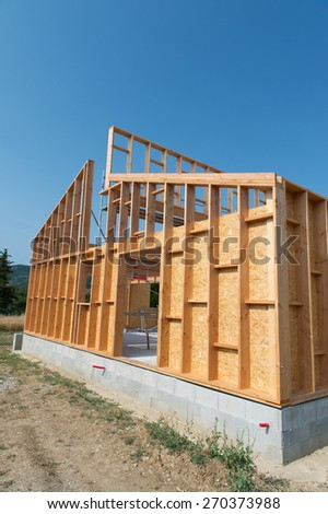 Frame of building a wooden house - stock photo