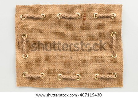 Frame of burlap, lies on a white background, can be used as texture - stock photo