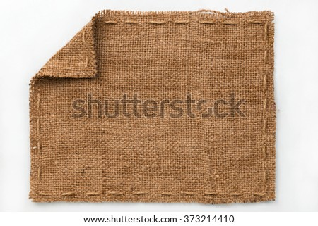 Frame of burlap with curled edges, lies on a white background, can be used as texture