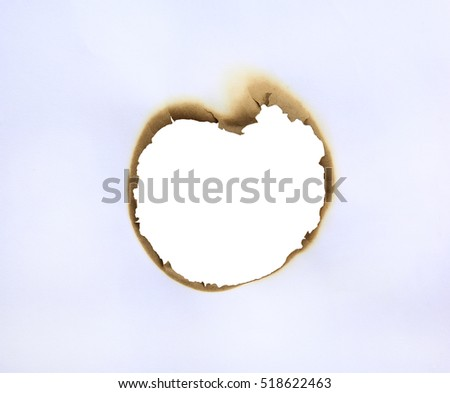 Frame of burned hole in paper like a heart.