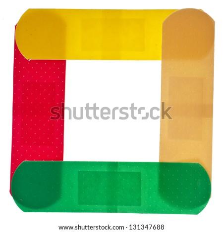 frame of colored adhesive bandage plaster  close up macro , isolated on a white background - stock photo