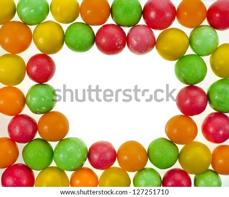 Frame of colored background of assorted candies balls - stock photo