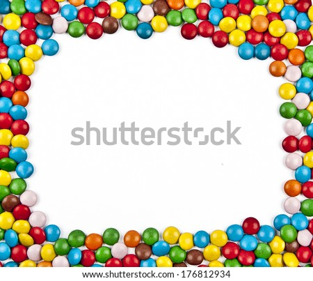 Frame of colorful candy on a white background with space for your text - stock photo