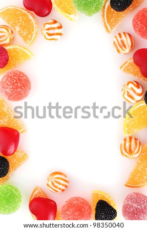 frame of colorful jelly candies isolated on white - stock photo