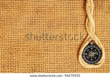 frame of compass and ropes on sack - stock photo