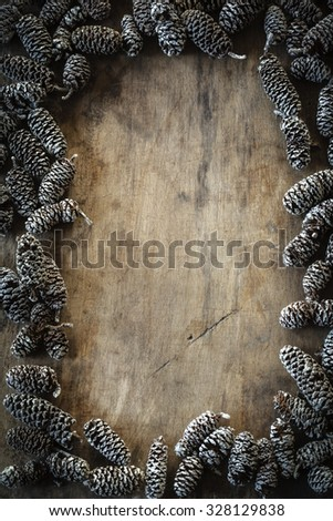 Frame of cones on wooden background
