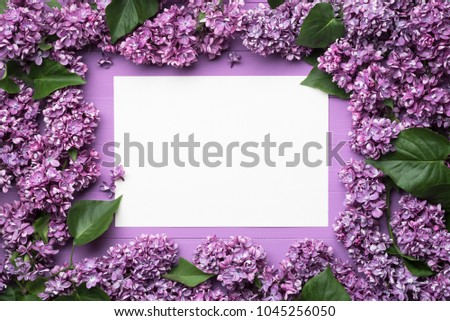 Frame of flowers and leaves with blank sheet for notes. Decor of lilac flowers