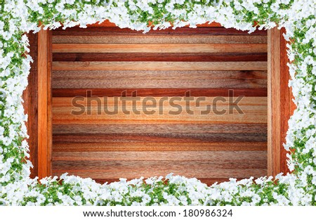 frame of flowers on wooden background