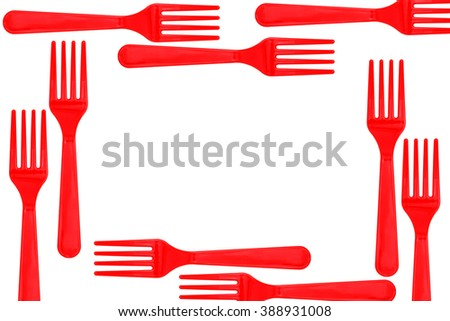 frame of plastic forks on wood background - stock photo