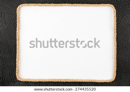 Frame of rope, lies on a background of a black natural leather, with place for your text - stock photo