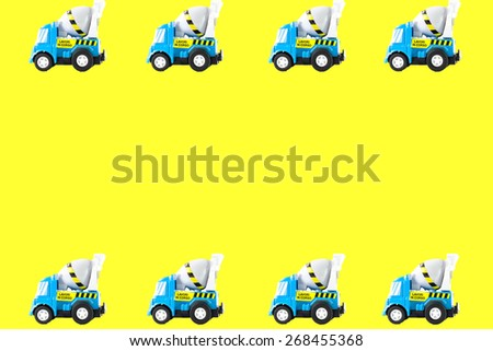 Frame of Toy cars. Concrete mixer Toys Truck. yellow background - stock photo