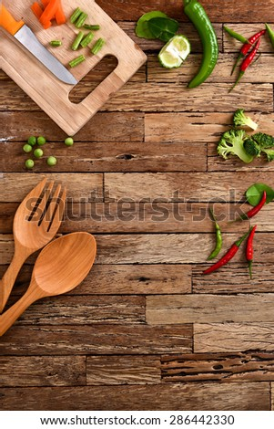 Frame of vegetables, herbs. chilli, kitchenware on wood background.  - stock photo