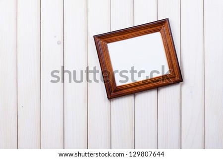 Frame on wooden wall background - stock photo