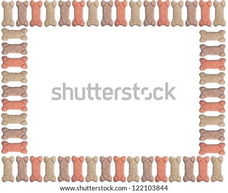 Frame or border consisting of multicolored dog biscuits - stock photo