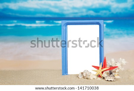 Frame, sea cockleshells and coral on the sandy coast - stock photo