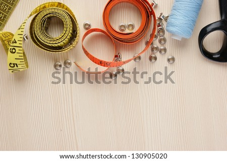 Frame sewing supplies on the table - stock photo