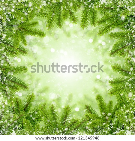 Frame the branches of pine with snow on abstract light background - stock photo