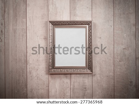 Frame vintage on wood wall - stock photo