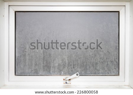 Frame window glass opaque with white aluminium in bathroom. - stock photo