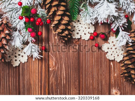 Frame winter decor on a wooden background. - stock photo