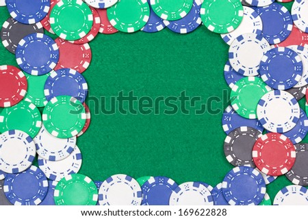 frame with colorful poker chips on the green casino table - stock photo