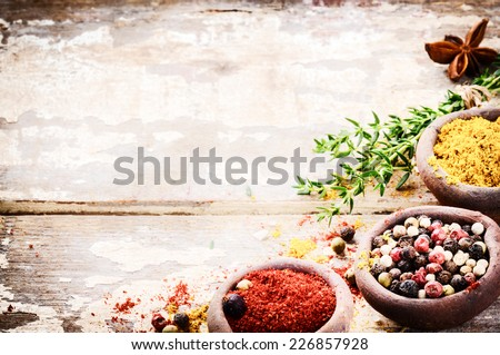 Frame with colorful spices on old wooden background  - stock photo