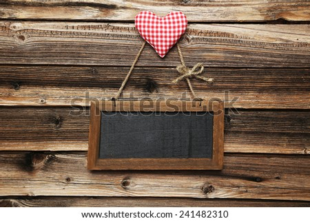 Frame with love heart  on wooden background - stock photo