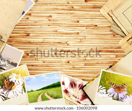 Frame with old paper and photos. Objects over bamboo planks - stock photo
