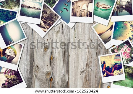 Frame with old paper and photos. Objects over wooden planks. - stock photo