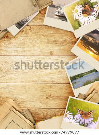 Frame with old paper and photos. Objects over wooden planks - stock photo