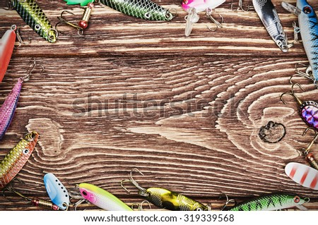 Frame with spinner lures and fishing bytes. Place empty can be used for text - stock photo