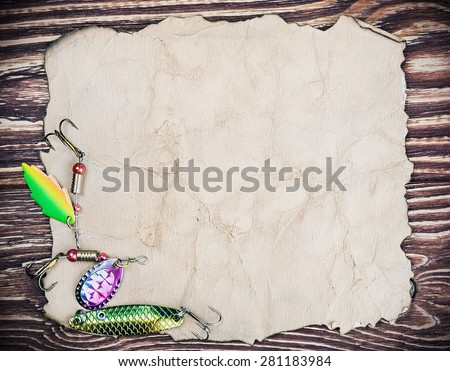 Frame with spinner lures and old paper for text - stock photo