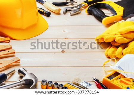 Frame with various tools on wooden background. Construction concept - stock photo