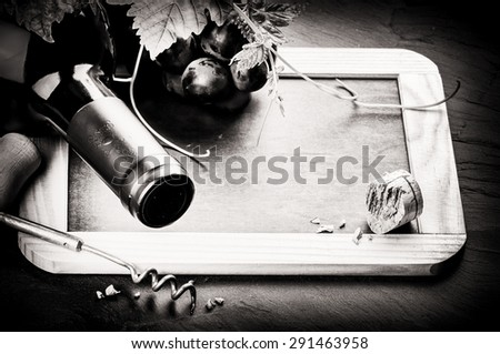 Frame with wine bottle and fresh grape. Black and white  - stock photo