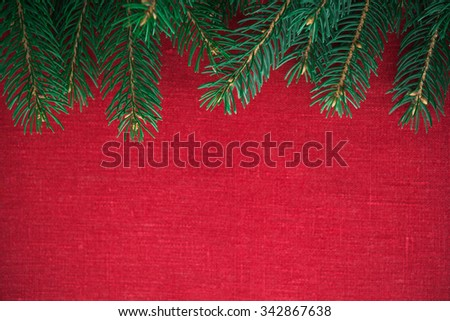Frame with xmas tree on red canvas background. Merry christmas card. Winter holiday theme. Space for text. Happy New Year. - stock photo